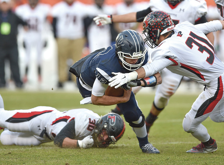 Valor Christian quarterback Dylan McCaffrey, shown here gaining yards on the ground in the state championship game against Pomona, is the Colorado Community Media South Metro Offensive Football Player of the Year.