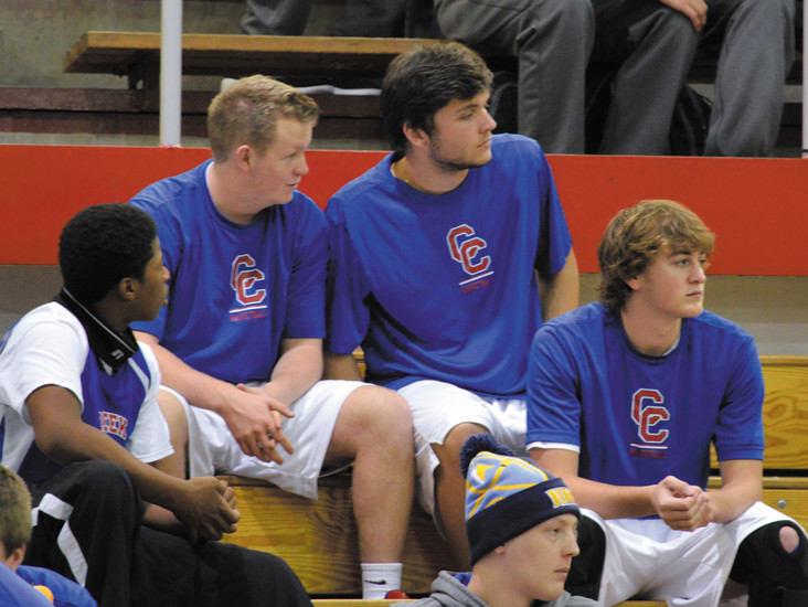 Cherry Creek players watch the Legend-Lincoln game while waiting to play their game against Pine Creek on Dec. 23 at the Cherry Creek Holiday Invitational tournament.