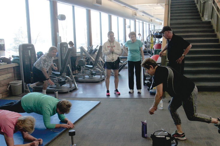 A group of seniors work out together at the Lone Tree Recreation Center. Committing to fitness with a group of friends helps members stay accountable, several fitness instructors say.
