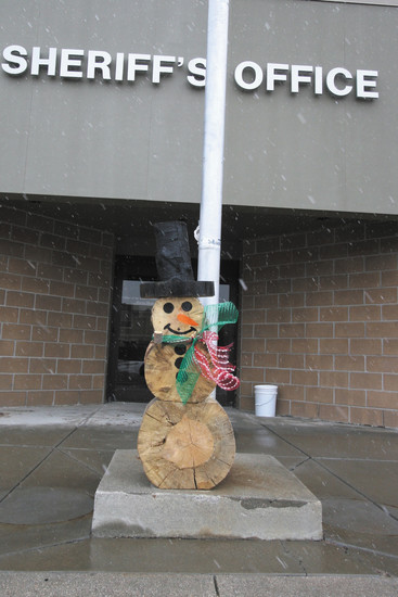 This wooden snowman was dropped off at the sheriff's office building in Kiowa.