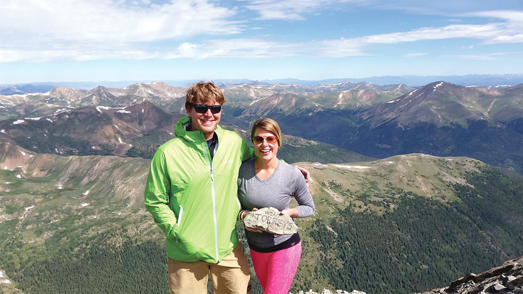 Mike Smith is an outdoorsy man who loves climbing 14ers. Shown here with his sweetheart, Catie, they stand after reaching the top of Mount Torreys last summer. Courtesy photo