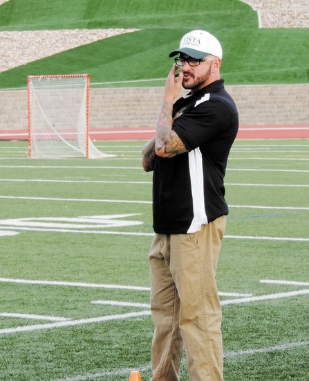 Jake Herman is shown on the sideline in 2014, his first season as Mountain Vista's boys lacrosse coach. File photo