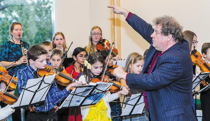 Thomas Blomster, director of the Colorado Chamber Orchestra, works with young musicians. Courtesy photo