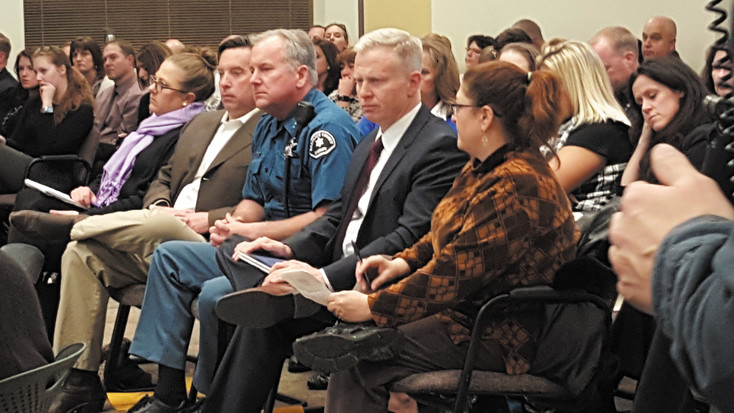 Sheriff Dave Walcher listens as the LPS Board of Education hears the results of the studies into the death of Claire Davis. On his left is District Attorney George Brauchler, and to his right is Michael Roche, the Davis family's attorney. Photo by Jennife
