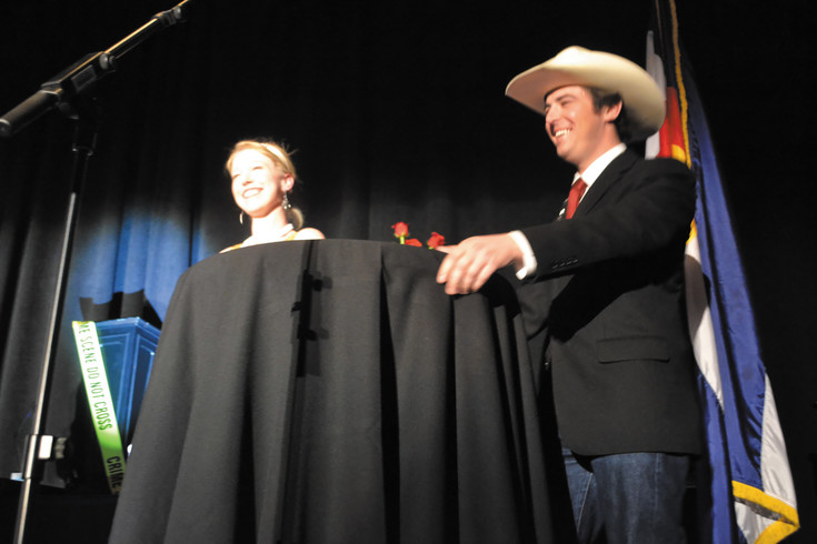 Carolyn Bond, left, and Chase Citrowski smile after their friendly trivia competition came to a close.
