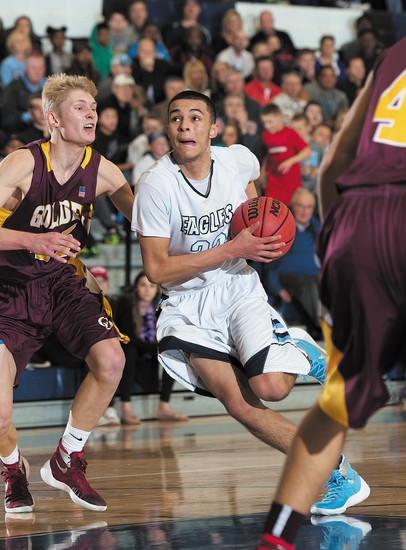 Valor Christian's Jalen Sanders drives to the hoop as he tries to get around Golden's Kayden Sund.  Valor avenged its earlier loss to Golden by winning 62-46 at Valor on Feb. 30.