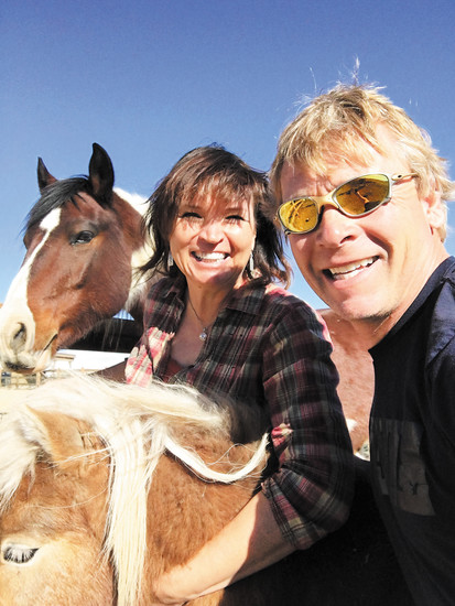 Kristi Cymes and her husband, Jon,  take a selfie while playing with George, a horse involved in youth summer camps at Standley Lake Stables. Courtesy photo