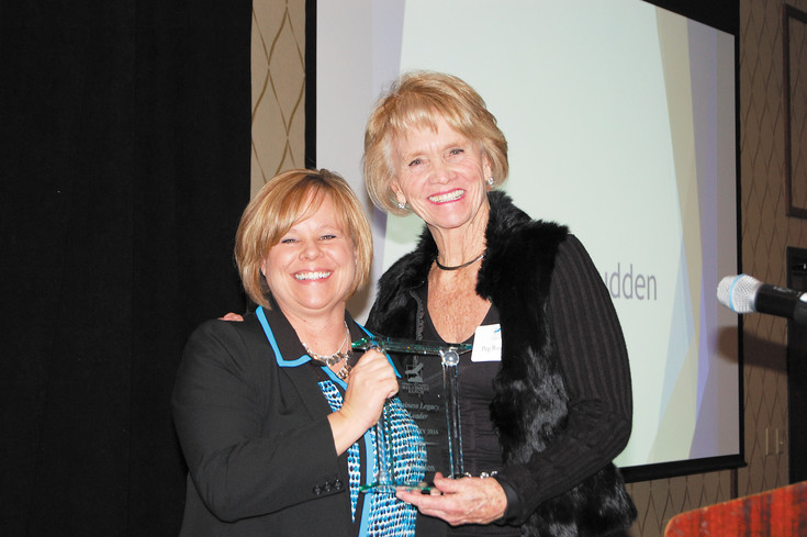 Peg Rudden from CASA, right, accepts the award for Business Legacy Leader from Andrea LaRew, president of the Highlands Ranch Chamber of Commerce.