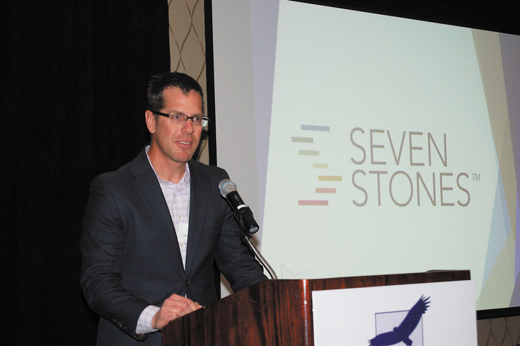 Doug Flin, vice president of planning and product development for Seven Stones, accepts the award for Emerging Business of the Year. Seven Stones tied with Bear Mortgage Inc. for the award.