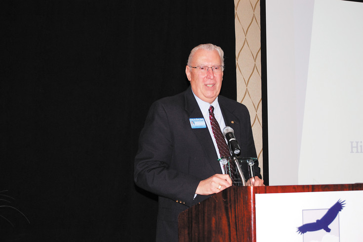 Jerry Wilford, Hide in Plain Sight's board chairman, accepts the award for Excellence in Community Impact.