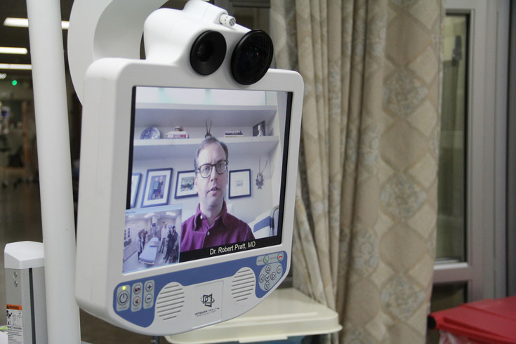 Dr. Robert Pratt appears live on a telemedicine device to treat stroke patients at Sky Ridge Medical Center. Pratt can operate the cameras from a tablet in his home.