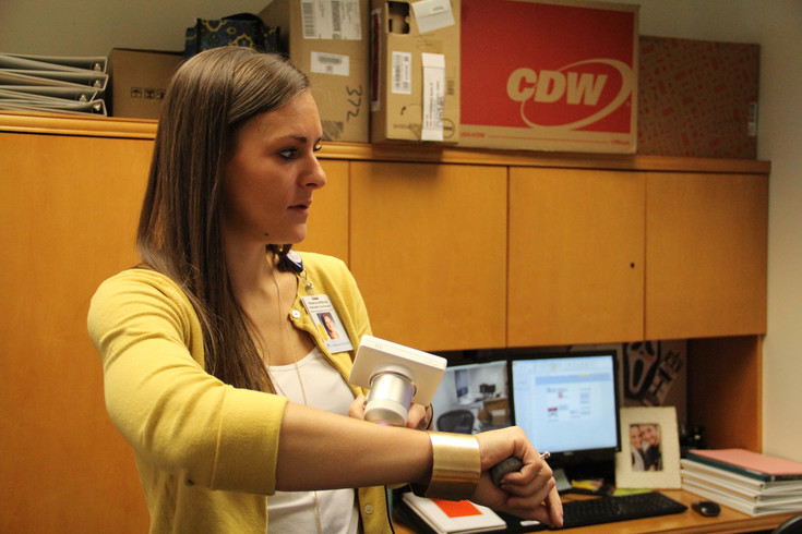 Rebecca McBride, Telehealth coordinator for Centura Health, demonstrates one of the camera attachments that can be used for telemedicine. Photo by Mike DiFerdinando
