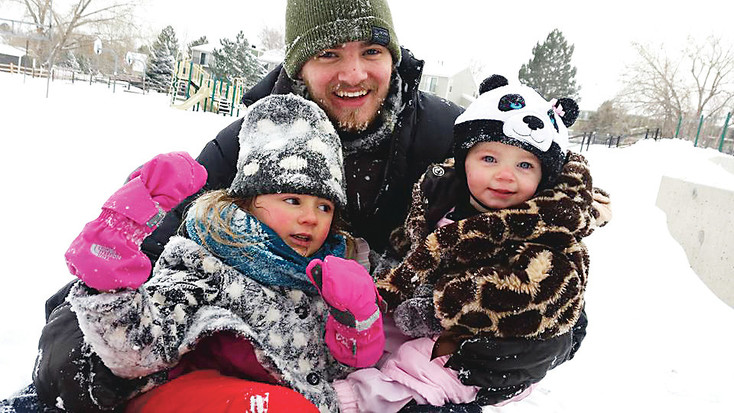 """When I'm not teaching, you can often find me playing around with my two little nieces,"" Collett says. ""We go sledding a lot on a hill by Warder Elementary School, and we love it."" Courtesy photo"