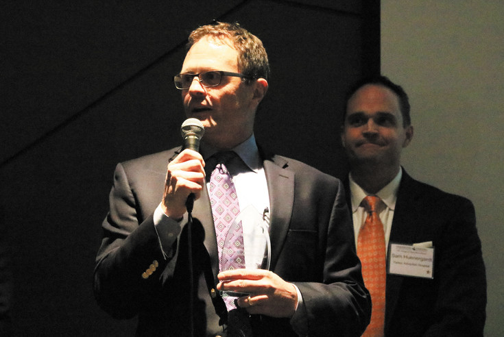 With Parker Adventist CEO Sam Huenergardt looking on, Tod Baker, left, CEO of Centennial-based startup MDValuate, talks about the role of technology in improving outcomes in medical settings. The company won the Digital Health Innovation Award Feb. 10.