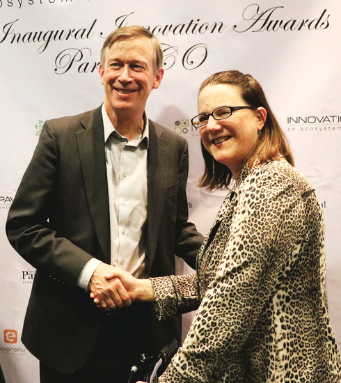 Jennifer Maskrey, founder and chief executive officer of the Parker-based tech startup QB Labs, meets with Gov. John Hickenlooper before an awards ceremony honoring entrepreneurs at the PACE Center Feb. 10. Photo by Chris Michlewicz