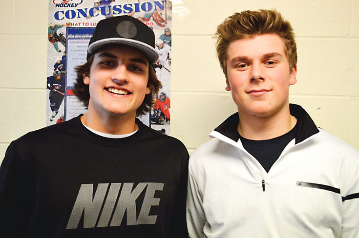 Defenseman Colby Bukes, left, and forward Baker Shore play for the Colorado Thunderbirds' U16 national elite hockey team. Neither have played high school hockey.
