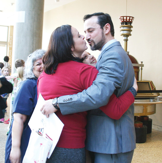 Dena Smith kisses her husband Cesar Nufio after he received his certificate of citizenship at a special President�s Day naturalization ceremony Feb. 17 at the History Colorado Center in downtown Denver.