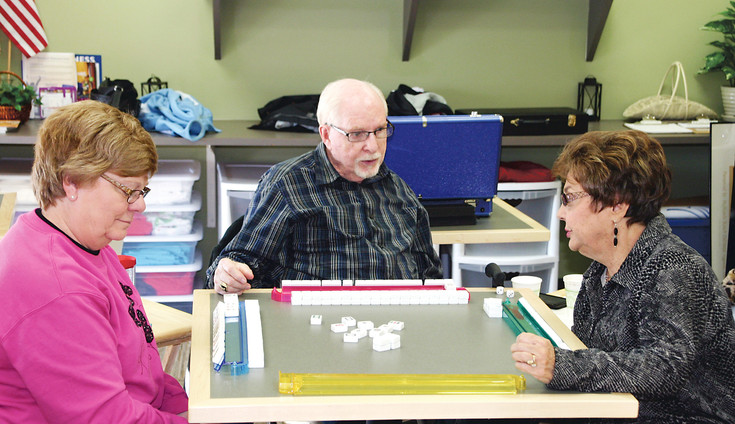 "From left, Sue Frommelt, 64, Ronald Levenson, 75, and Marilyn Levenson, 71, enjoy small talk over a game of Chinese Mahjong at the Southridge Recreation Center. ""We didn't want to move from this area,"" Marilyn Levenson said of her relocation to Lone Tree."