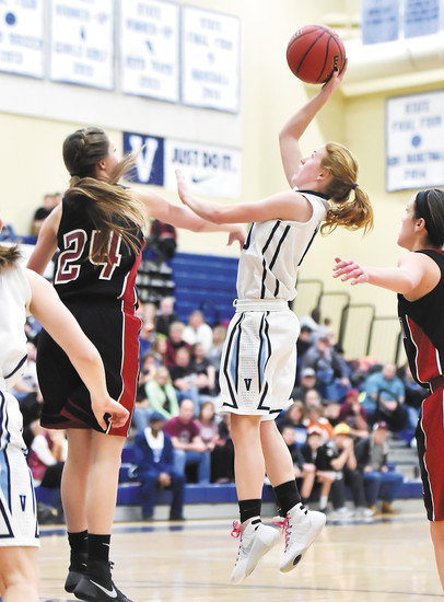 Valor Christian's Tess Boade (10) goes up for the jumper as Fort Morgan's Riley Bauman (24) tries to swat the ball away in the opening round of the Class 4A playoffs Feb. 26.  Valor went on to win 85-31 and then took a 68-36 victory over Berthoud to advance to the Great Eight round against Mullen on March 4.