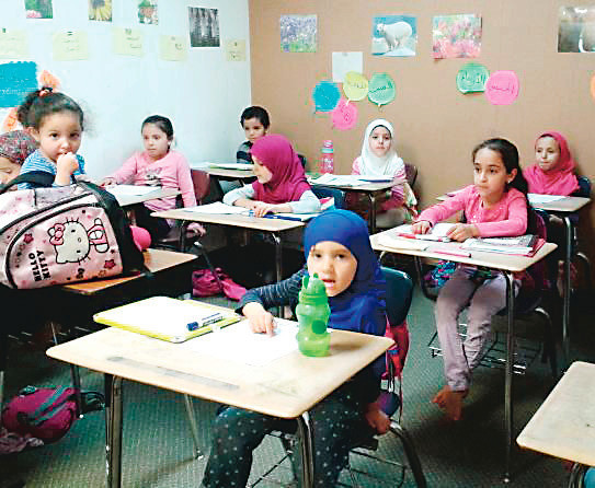 Children learn Arabic on Feb. 26 in a classroom at the Denver Islamic Society. People attend mosques to pray, but mosques also serve the community as a place for education and social gathering.