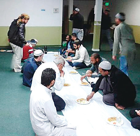A mosque is the main place of gathering for the Muslim community. Here, men share a meal on Feb. 26 at the Denver Islamic Society, which is located near I-25 and Evans Avenue. A person may attend any mosque that is convenient, and some Muslims choose a mosque for the different programs offered.