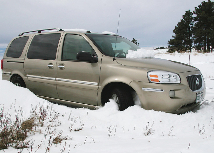 A vehicle stuck in the snow was a familiar site during the March 23 storm.