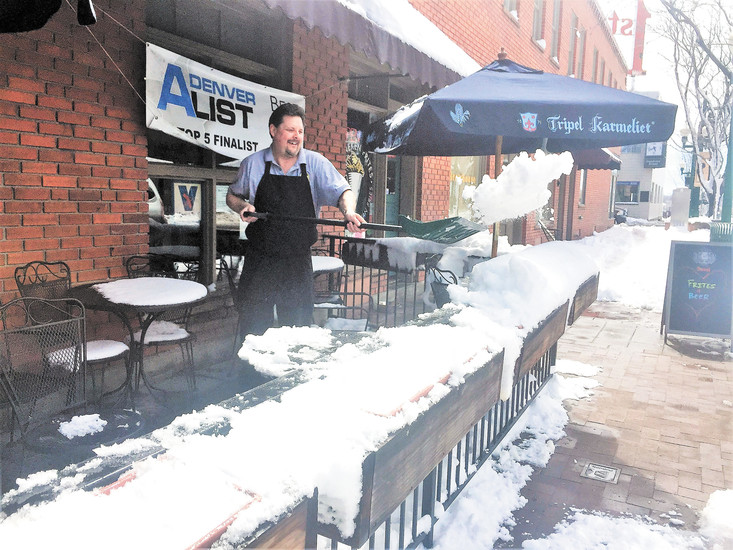 On a warm Thursday morning, the day after the March 23 storm that dumped more than 10 inches of snow in Arvada's Olde Town, Manneken Frites owner, Chris Stromberg, happily shovels off his porch to make room for the afternoon's customers.