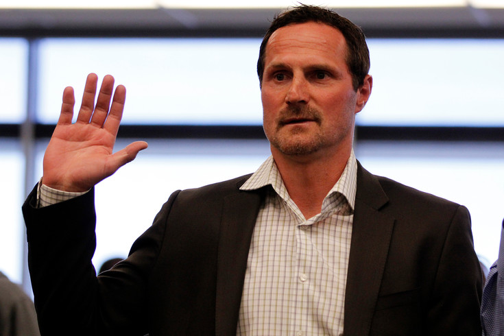 Milan Hejduk, retired Colorado Avalanche right winger, raises his hand to take a loyalty oath during a naturalization ceremony on Monday, March 28, 2016. The ceremony at the United States Citizenship and Immigration Services Building in Centennial naturalized 32 applicants as U.S. citizens. Photo by Tom Skelley.