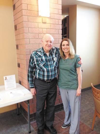 Registered Nurse Kirsten Antony, right, and client Steve Lange at a local foot care clinic. Antony specializes in foot and  nail care, reflexology, healing touch and massage.