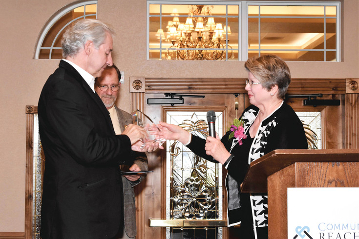 Vern Tharp, husband of Rep. Tracy Kraft-Tharp (D-29) of Arvada, accepts his wife's Legislative Leadership Award from Fuselier as the Community Reach Center CEO Rick Doucet looks on at the 2016 Annual Mary Ciancio Memorial Distinguished Service Award Dinner, April 13 at Stonebrook Manor in Thornton. Kraft-Tharp sponsored a bill last year, signed into law by Gov. John Hickenlooper, which created a suicide prevention commission in Colorado.