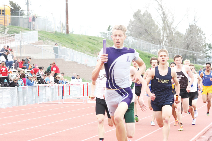 Nicholas Runco runs the initial leg for the Lutheran 4x800-meter relay team at the April 22-23 Liberty Bell Invitational Track Meet. The team finished fourth in the event and Lutheran finished second in the boys team standings.
