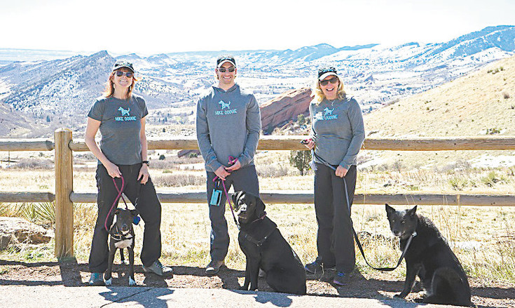 The Hike Doggie team, from left, Kath Allen with LuLu, Stephen Hillen with Henry and Sharie Thompson with Bria, launched the dog hiking business on May 2, and will celebrate at its Sniff 'n Social event from 2-6 p.m. May 14 at Lions Park, 1300 10th St., in Golden.
