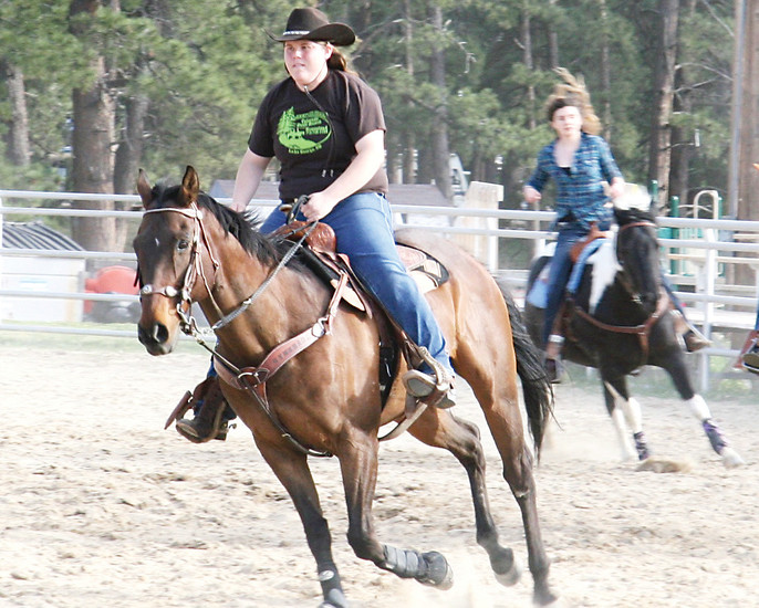 "Sierra Taylor trains with her fellow riders on the Blazing Saddles Drill Team. Taylor is one of the most experienced riders on the team and enjoys performing the ""fast lap,"" which is a high-speed lap of the arena around a slower circle of riders toward the center."