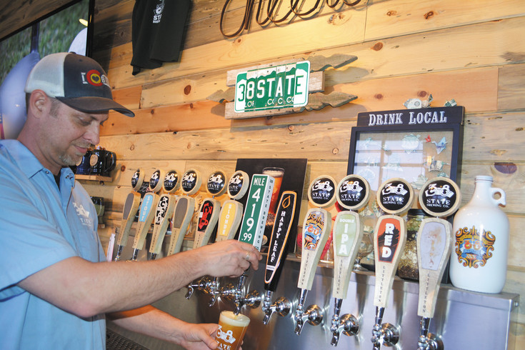 Steve Schuett, general manager at 38 State Brewing, pours a pint of the brewery's Mile 419.99 Rye pale ale on April 29. Shuett says that breweries are beginning to replace neighborhood bars.