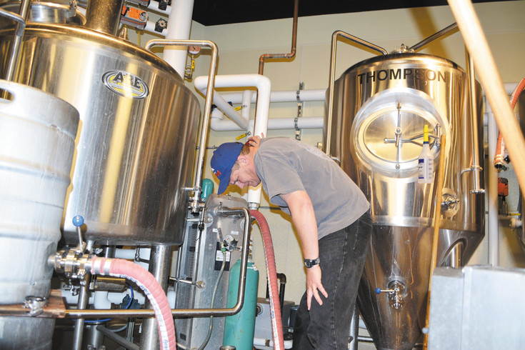 Locavore Beer Works co-owner Andy Nelson gets ready to brew some beer. Nelson and co-owner Jason Reinhardt met in a homebrewing club and opened Locavore in 2014.
