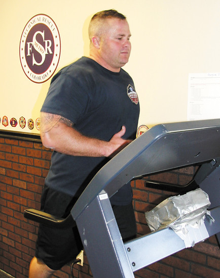 Physical fitness is a part of the workday for firefighters and paramedics, like Jamin Cook.