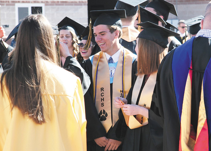 Rock Canyon Seniors share a laugh ahead of graduation. The school held ceremonies at Sports Authority Stadium in Parker on May 20.