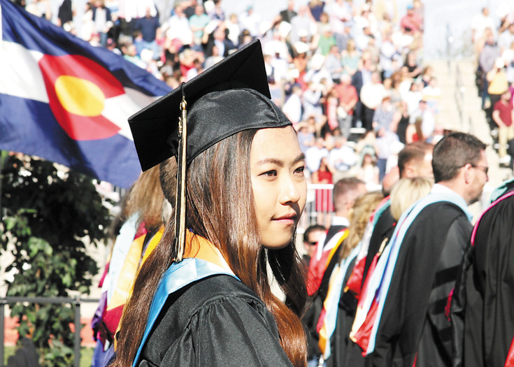 Rock Canyon High School Valedictorian Ji Woo Park waits to deliver her Class Address. Park told her fellow graduates that there is nothing holding them back from completing the mosaic of their lives.