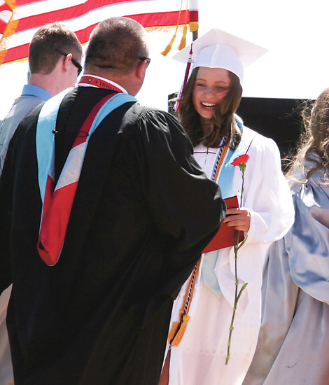 Elizabeth High School Valedictorian Marianne Hughes is congratulated. Hughes earned a Grade Point Average of 4.27, the highest in the 2016 graduation class.
