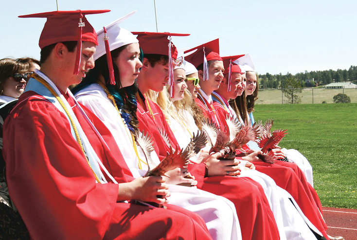 Elizabeth High School Valedictorians sit with faculty. This year's class had ten students with a grade point averages of 4.0 or higher.