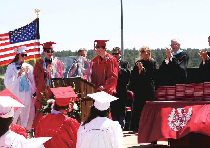 Co-valedictorian, Zack Neelley, receives a standing ovation from his class and faculty for his tribute to his younger brother Hunter and to a future with hope. Hunter Neelley died of bone cancer in 2014.