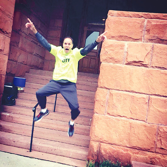 Rev. David Warren with Open Door Ministries kicked off a campaign this spring to run 100 miles to 100 churches to raise awareness of the May 28 Run for the Door 5K race benefiting Denver metro area homeless. Here, Warren takes a leap off the steps of KPOF AM 91 in Westminster.