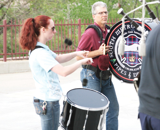 Drummers Niamh Kennedy, tenor drum, and Brian Page Base, drum, join with pipers at their weekly practice. Though not a firefighter, Kennedy is welcomed to play and perform with the band.