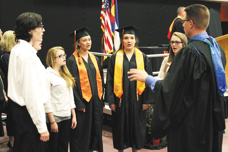Music Instructor Toy Vruggink leads the Kiowa Ensemble. The group opened graduation at Kiowa High School with the National Anthem.