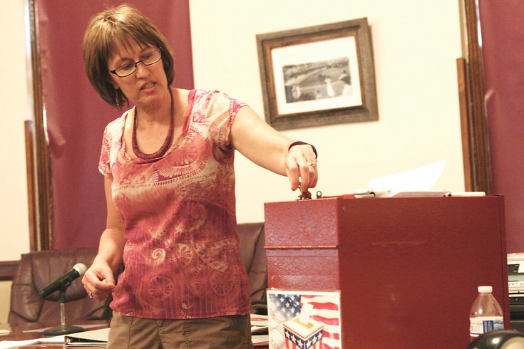 Election Manager Rhonda Braun explains how tamper-proof seals protect ballot integrity. Each time a seal is broken to open a ballot box or post office mail tub, the seal number must be logged.