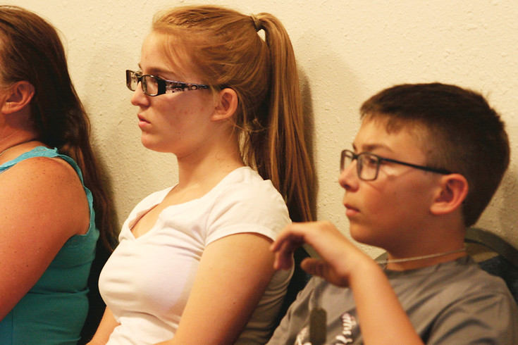 Samantha Bennett and brother Tyler listen to the voter presentation at the County Courthouse in Kiowa on June 9. Both are involved in scouting and are working on citizenship merit badges for their respective scouting organizations.