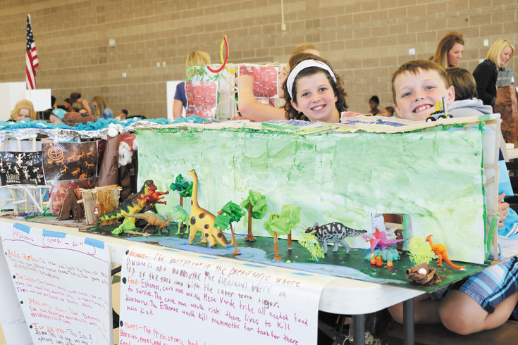 From left - Rowan LaPiano and Luke Eaton, fifth graders at Mammoth Heights Elementary School, showcase their prehistoric model at the June 6 Student Expo. The duo spent about four months creating an intricate display of climate change - one side includes mammoths and igloos; the other has vegetation and dinosaurs.