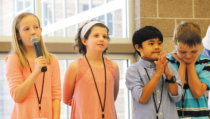 "From left - Fifth graders at Mammoth Heights Elementary School, Clara Huffman, Aiden Vidal, Rowan LaPiano, and Luke Eaton, tell other Student Expo participants and guests what they liked most about the June 6 event at JMountain Vista High School. ""Our class worked really hard to get here,"" Huffman said."