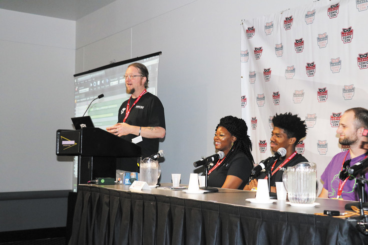Representatives of Rocky Mountain College of Art + Design's Digital Art Forge discuss their virtual reality comic at a panel at Denver Comic Con on June 17.
