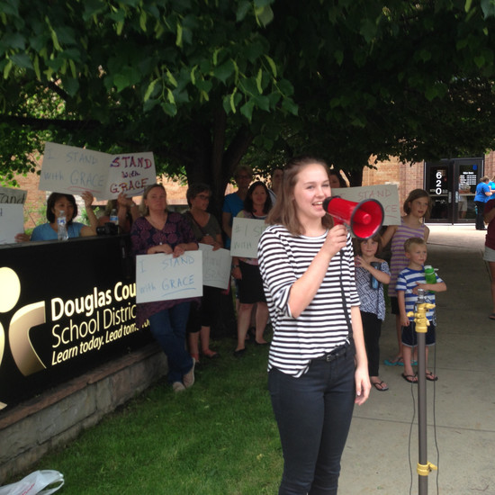 Ponderosa High School student Grace Davis speaks to a crowd outside of the Douglas County School District building in Castle Rock June 21.